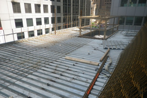 a bare roof deck in a city commercial zone