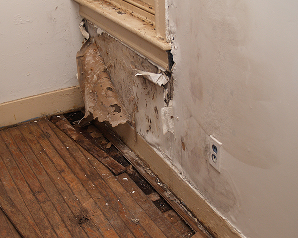 A water damaged interior wall in an old house