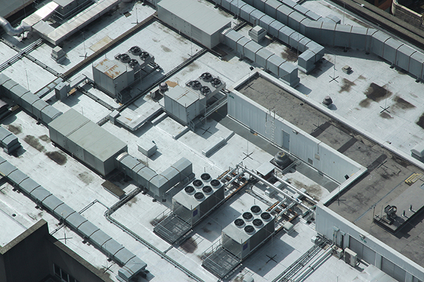 Rooftop of a huge industrial building with TPO roofing system.