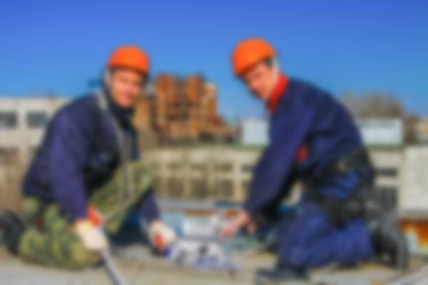 two contractors facing on roof facing camera